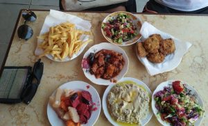 A picture of several dishes of cheap yummy food in Egypt