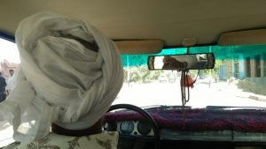 How to travel with little money Picture of a driver of car in a turban in Egypt
