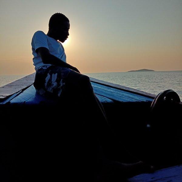 silhouette man boat